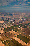 Aerial shot showing intersection between rural and suburban communities and land,  near Brentwood, California