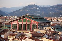 High angle view of San Lorenzo Mercato Centrale (Central Market), 1870-74, by Giuseppe Mengoni, Florence, Tuscany, Italy, pictured on June 10, 2007, in the afternoon with the surrounding landscape. This elegant cast-iron and glass building still houses a thriving market. Florence, capital of Tuscany, is world famous for its Renaissance art and architecture. Its historical centre was declared a UNESCO World Heritage Site in 1982. Picture by Manuel Cohen.