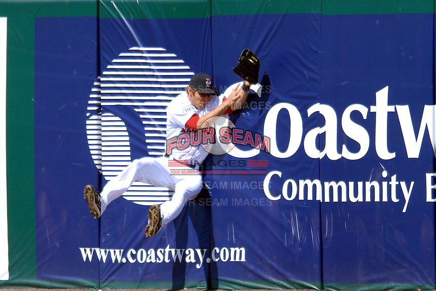 Outfielder Josh Reddick #24 of the Pawtucket Red Sox makes a leaping catch during a game against the Buffalo Bisons on April 17, 2011 at McCoy Stadium in Pawtucket, Rhode Island.  Photo By Ken Babbitt/Four Seam Images