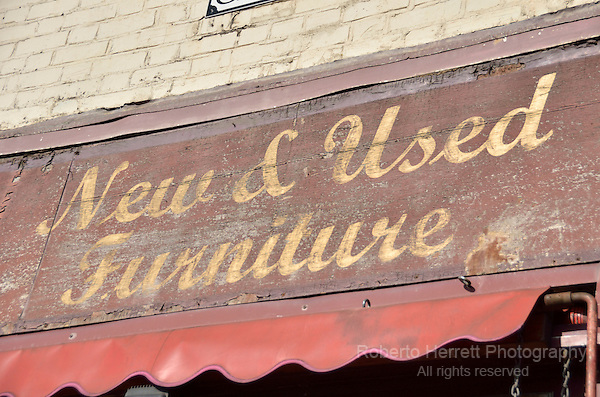 New and Used Furniture sign above a shop