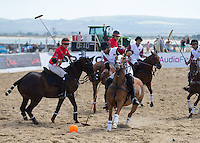 Tito Gaudenzi of England in action during the Wales v England match at the Asahi Beach Polo Championship  at Sandbanks, Poole, England on 10 July 2015. Photo by Andy Rowland.