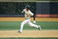 Bruce Steel (17) of the Wake Forest Demon Deacons hustles towards second base during the game against the Notre Dame Fighting Irish at David F. Couch Ballpark on March 10, 2019 in  Winston-Salem, North Carolina. The Demon Deacons defeated the Fighting Irish 7-4 in game one of a double-header.  (Brian Westerholt/Four Seam Images)