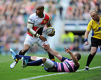 Tom Varndell of London Wasps escapes the clutches of Charlie Sharples of Gloucester Rugby during the Aviva Premiership match between London Wasps and Gloucester Rugby at Twickenham Stadium on Saturday 19th April 2014 (Photo by Rob Munro)