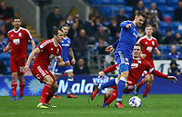 Joe Ralls of Cardiff City breaks free from the challenges of Craig Gardner of Birmingham City during the Sky Bet Championship match between Cardiff City and Birmingham City at The Cardiff City Stadium, Cardiff, Wales, UK. 11 March 2017