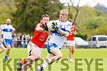 Stan Divane Castleisland Desmondsgets to the ball ahead of Brosna's Peter Curtin during their Intermediate Club Championship relegation play off in Cordal on Sunday
