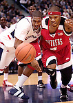 HARTFORD, CT. 03 February 2007-020307SV09--#1 Marcus Johnson of UConn and #4 Adrian Hill of Rutgers scramble for the loose ball during basketball action at the Hartford Civic Center in Hartford Saturday.<br /> Steven Valenti Republican-American