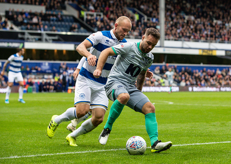 Blackburn Rovers' Adam Armstrong competing with Queens Park Rangers' Toni Leistner (left) <br /> <br /> Photographer Andrew Kearns/CameraSport<br /> <br /> The EFL Sky Bet Championship - Queens Park Rangers v Blackburn Rovers - Saturday 5th October 2019 - Loftus Road - London<br /> <br /> World Copyright © 2019 CameraSport. All rights reserved. 43 Linden Ave. Countesthorpe. Leicester. England. LE8 5PG - Tel: +44 (0) 116 277 4147 - admin@camerasport.com - www.camerasport.com