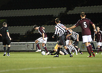 Dylan McGowan wins the ball from Jordan Holt in the St Mirren v Heart of Midlothian Clydesdale Bank Scottish Premier League U20 match played at St Mirren Park, Paisley on 6.11.12.
