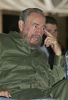 "The Cuban President Fidel Castro attend the presentation of the book ""The Fugitive Instant"" of the Argentinean writer Miguel Bonasso, in the Museum of ""Bellas Artes"" in Havana, Cuba, Saturday, June 11, 2005.The book ""The Fugitive Instant"" narrates chronic of the Cuban Revolution, of Hugo Chavez, President from Venezuela and Nestor Kirtchner of Brazil.  Credit: Jorge Rey/MediaPunch"