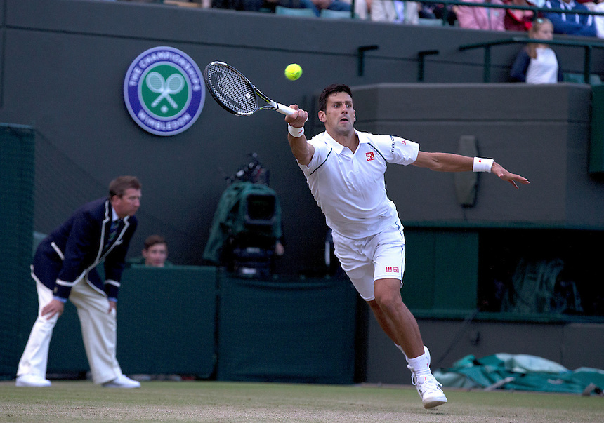 Novak Djokovic (SRB) [1] in action against Kevin Anderson (RSA) [14] in their Gentlemen's Singles Fourth Round match today<br /> <br /> Photographer Stephen White/CameraSport<br /> <br /> Tennis - Wimbledon Lawn Tennis Championships - Day 7 - Monday 6th July 2015 -  All England Lawn Tennis and Croquet Club - Wimbledon - London - England<br /> <br /> &copy; CameraSport - 43 Linden Ave. Countesthorpe. Leicester. England. LE8 5PG - Tel: +44 (0) 116 277 4147 - admin@camerasport.com - www.camerasport.com.