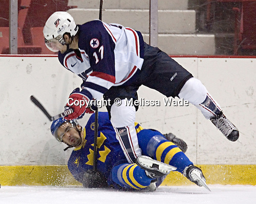 Daniel Rahimi 3 of Sweden manages to trip up Matt Butcher 17 of the United States after being hit.  Team USA White defeated Team Sweden 5-3 on Friday, August 11, 2006, at the 1980 Rink in Lake Placid, New York in their final game of the US Under-20 Training Camp and Summer Hockey Challenge.