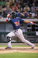 Henry Ramos (34) of the Pawtucket Red Sox follows through on his swing against the Charlotte Knights at BB&T BallPark on July 6, 2016 in Charlotte, North Carolina.  The Knights defeated the Red Sox 8-6.  (Brian Westerholt/Four Seam Images)