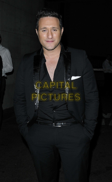 Antony Costa.The British Inspiration Awards, InterContinental Hotel, Park Lane, London, England..May 24th, 2012.half length black suit hands in pockets.CAP/CAN.©Can Nguyen/Capital Pictures.