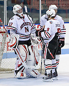 Chris Rawlings (NU - 37), Garrett Vermeersch (NU - 9), Jake Newton (NU - 5) - The Northeastern University Huskies defeated the St. Thomas Tommies 7-5 in their exhibition match on Saturday, October 3, 2009, at Matthews Arena in Boston, Massachusetts.
