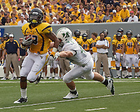 WVU running back Andrew Buie. The WVU Mountaineers beat the Marshall Thundering Herd 34-13 in a game called just after the fourth quarter started because of severe thunderstorms in the area. The game was played at Milan Puskar Stadium in Morgantown, West Virginia on September 4, 2011.