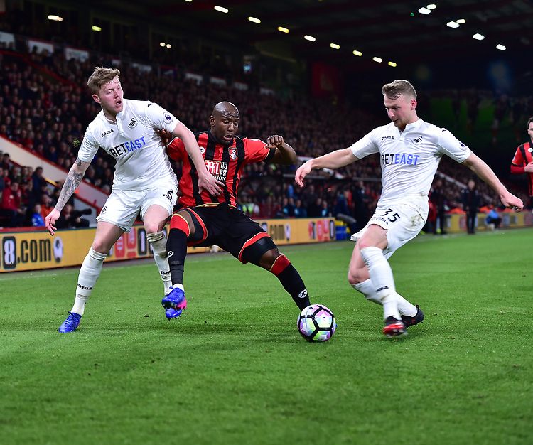Swansea City's Alfie Mawson (L) and Swansea City's Wayne Routledge (R) battle with Bournemouth's Benik Afobe (C)<br /> <br /> Bournemouth 2 - 0 Swansea<br /> <br /> Photographer David Horton/CameraSport<br /> <br /> The Premier League - Bournemouth v Swansea City - Saturday 18th March 2017 - Vitality Stadium - Bournemouth<br /> <br /> World Copyright &copy; 2017 CameraSport. All rights reserved. 43 Linden Ave. Countesthorpe. Leicester. England. LE8 5PG - Tel: +44 (0) 116 277 4147 - admin@camerasport.com - www.camerasport.com