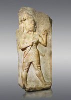 Picture &amp; imafe of Relief of God of War. Limestone, Kings Gate, Hattusa ( Bogazkoy ). 14th - 13th Century BC. Anatolian Civilisations Museum, Ankara, Turkey.<br /> <br /> The warrior depicted in high relief is dressed in a decorated skirt. The relief takes place on the interior part of the King's gate facing city, to the east of the city walls. He carries a crescent-handled short sword in his belt. The relief is identified as god depiction since the horns on the headdress are the indication of a god.  <br /> <br /> Against a gray background.