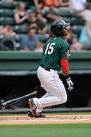 Second baseman Yoan Moncada (24) of the Greenville Drive bats in a game against the Rome Braves on Sunday, June 14, 2015, at Fluor Field at the West End in Greenville, South Carolina. The Cuban-born 19-year-old Red Sox signee has been ranked the No. 1 international prospect in baseball by Baseball America. (Tom Priddy/Four Seam Images)
