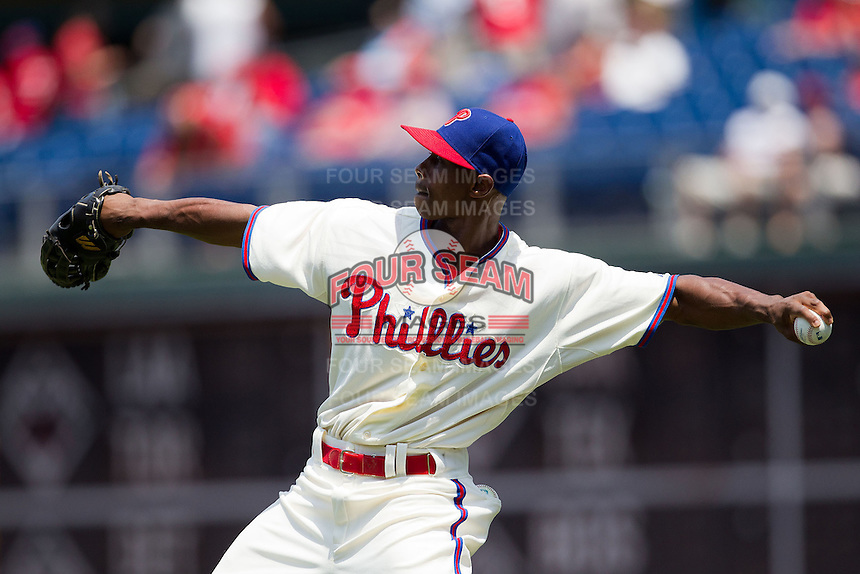 Philadelphia Phillies outfielder Juan Pierre #10 warms up before the Major League Baseball game against the Pittsburgh Pirates on June 28, 2012 at Citizens Bank Park in Philadelphia, Pennsylvania. The Pirates defeated the Phillies 5-4. (Andrew Woolley/Four Seam Images).