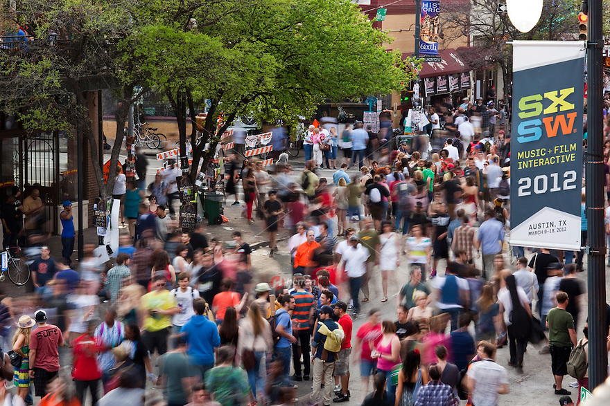 Sixth Street Bars and music venues are filled to capacity as the SXSW attendees celebrate, with music spilling out onto 6th Street