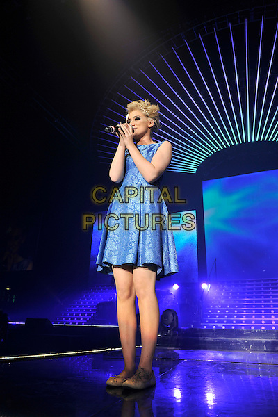 KATIE WAISSEL .performs during The X Factor Live tour, Wembly Arena, London, England, .March 5th 2011..music concert gig on stage full length blue dress sleeveless print patterned microphone singing ballet flats shoes pumps .CAP/MAR.© Martin Harris/Capital Pictures.