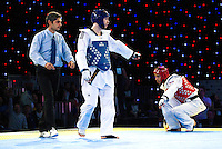 05 MAY 2012 - MANCHESTER, GBR - Aaron Cook (GBR) of Great Britain (centre in blue) points out a percieved infraction by his opponent Ramin Azizov (AZE) of Azerbaijan during the men's 2012 European Taekwondo Championships -80kg final at Sportcity in Manchester, Great Britain (PHOTO (C) 2012 NIGEL FARROW)