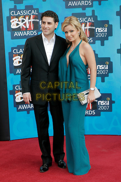 JUAN DIEGO FLOREZ & KATHERINE JENKINS .The Classical Brit Awards 2007, Royal Albert Hall, London, England. .May 3rd, 2007.full length jumpsuit catherine green blue turquoise catsuit trousers pantsuit halterneck black suit jacket silver clutch purse.CAP/AH.©Adam Houghton/Capital Pictures