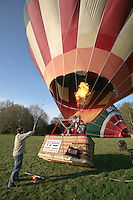 Making final adjustments prior to flight, British School of ballooning, Ebernoe, West Sussex.