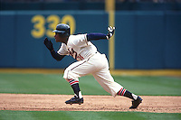 OAKLAND, CA - Rickey Henderson of the Oakland Athletics in action during an old timers game wearing a Oakland Oaks uniform game at the Oakland Coliseum in Oakland, California in 1995. Photo by Brad Mangin