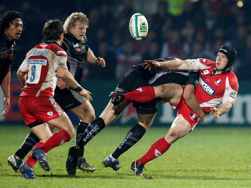 Photo: Richard Lane/Richard Lane Photography..Gloucester Rugby v Ospreys. Heineken Cup. 16/11/2007. .Gloucester's Andy Titterrell passes out of the tackle.