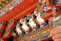 Carved animal protector deities guard the entrance to Kelsang Potrang, summer residence of the 18th century 8th Dalai Lama, at Norbulingka, founded by the 7th Dalai Lama in 1755, Lhasa, Tibet, China.