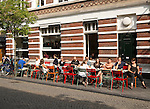 People sitting outside Zondag street cafe for breakfast, Maastricht, Limburg province, Netherlands