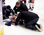 Södertälje 2013-02-02 Ishockey Allsvenskan , Södertälje SK - BIK Karlskoga :  .BIK Karlskoga 19 Björn Kindahl ses till av sjukvårdspersonal efter tuff tackling mot sargen.(Foto: Kenta Jönsson) Nyckelord: