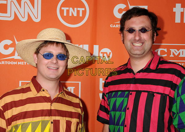 TIM HEIDECKER & ERIC WAREHEIM.Turner Summer 2008 TCA Party at the Beverly Hilton Hotel, Beverly Hills, California, USA..July 11th, 2008.half length pink red black orange green yellow pattern shirt striped stripes hat sunglasses shades.CAP/ADM/BP.©Byron Purvis/AdMedia/Capital Pictures.