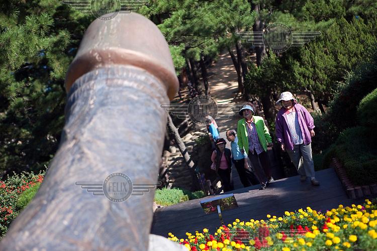 A phallic sculpture at Haisindang Park, a popular tourist destination.
