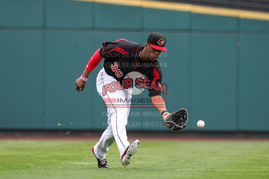 Left fielder Adam Walker (30) of the Rochester Red Wings fields a ground ball against the Scranton Wilkes-Barre Railriders on May 1, 2016 at Frontier Field in Rochester, New York. Red Wings won 1-0.  (Christopher Cecere/Four Seam Images)