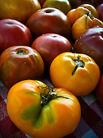 Heirloom red and green tomatoes for sale at a farmers market