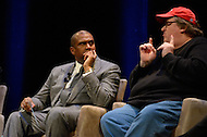 January 12, 2012  (Washington, DC) Academy Award winning filmmaker Michael Moore (right) speaks during a panel discussion on restoring America's prosperity at the George Washington University Lisner Auditorium in Washington. The program was moderated by Radio and television talk show host Tavis Smiley (left).  (Photo by Don Baxter/Media Images International)