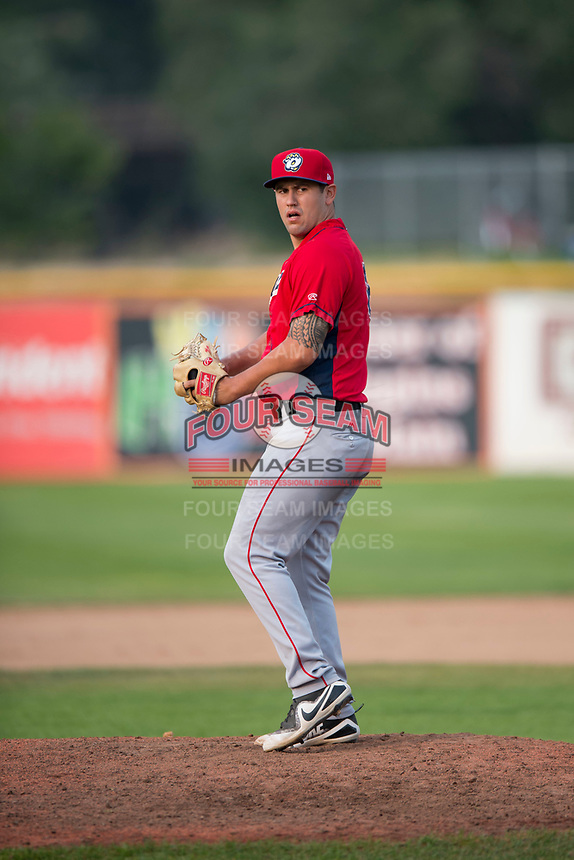 Orem Owlz relief pitcher Johnny Morell (18) gets ready to deliver a pitch during a Pioneer League game against the Missoula Osprey at Ogren Park Allegiance Field on August 19, 2018 in Missoula, Montana. The Missoula Osprey defeated the Orem Owlz by a score of 8-0. (Zachary Lucy/Four Seam Images)