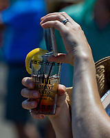 ELMONT, NY - JUNE 10: A woman takes a photo with her phone while holding her drink on Belmont Stakes Day at Belmont Park on June 10, 2017 in Elmont, New York (Photo by Scott Serio/Eclipse Sportswire/Getty Images)