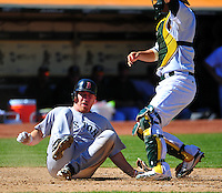 Sept. 12, 2010 - Oakland California, U.S. - Boston Red Sox's Mike Lowell slides to score beneath Oakland Athletics catcher Kurt Suzuki during the sixth inning of a baseball game Sunday, Sept. 12, 2010, in Oakland, Calif. Lowell scored on a double by teammate Ryan Kalish.  The Red Sox won the Game 5-3. (Photo by Alan Greth)