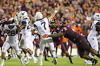 Landover, MD - September 3, 2017: Virginia Tech Hokies defensive tackle Tim Settle (4) forces West Virginia Mountaineers quarterback Will Grier (7) to pass the ball during game between Virginia Tech and WVA at  FedEx Field in Landover, MD.  (Photo by Elliott Brown/Media Images International)