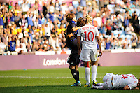 25.07.2012 Coventry, England. Aya MIYAMA (Japan) celebrates the second goal for Japan as Carmelina MOSCATO (Canada) lies injured during the Olympic Football Women's Preliminary game between Japan and Canada from the City of Coventry Stadium