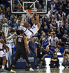 Nevada forward Trey Porter (15) dunks the ball against San Diego State in the first half of an NCAA college basketball game in Reno, Nev., Saturday, March 9, 2019. (AP Photo/Tom R. Smedes)