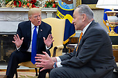 US President Donald J. Trump (L) listerns US Senate Minority Leader Chuck Schumer (R) exchange words during a meeting that included US House Speaker-designate Nancy Pelosi (not pictured), in the Oval Office of the White House in Washington, DC, USA, 11 December 2018. Trump, Pelosi and Schumer had a disagreement on border policy and shutting down the government.<br /> Credit: Michael Reynolds / Pool via CNP