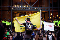Protesters gather at 125 High Street as part of the OccupyBoston demonstration in the Financial District of downtown Boston, Massachusetts, USA. The protesters are part of  OccupyBoston, which is part of the OccupyWallStreet movement, expressing discontent with the socioeconomic situation of the 99% of the US population who are not wealthy.  Protestors have been camping in Dewey Square since Sept. 30, 2011. Gradually, larger organizations, including major labor unions, have expressed their support for the OccupyBoston effort.  On this day, Oct. 5, members of National Nurses United, the largest nurses' union in the US, marched alongside the OccupyBoston protesters.