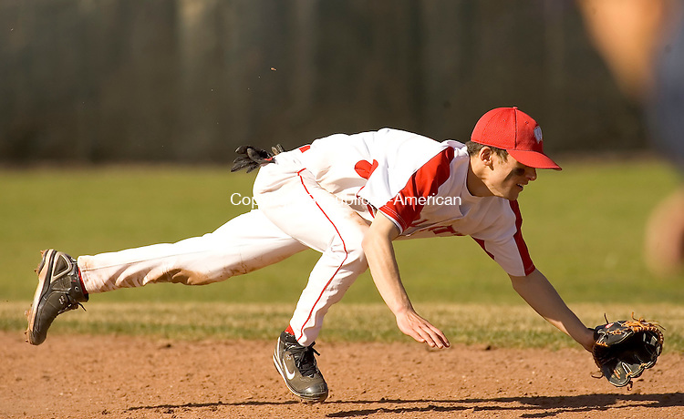 WOLCOTT, CT--19 APRIL 2007--041907JS09- Wolcott Tom Jannetty dives for a ball that got past him during their game Thursday against Naugatuck at Wolcott High School.<br /> Jim Shannon / Republican-American