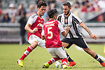 Juventus' player Grigoris Kastanos contests the ball against South China's player Sean Tse Ka Keung and South China's player Chak Ting Fung during the South China vs Juventus match of the AET International Challenge Cup on 30 July 2016 at Hong Kong Stadium, in Hong Kong, China.  Photo by Marcio Machado / Power Sport Images