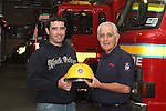 Oliver Flanagan handing over the helmet to his son John Paul on retiring from the Fire Service in his 40th year in Service...(Photo credit should read Jenny Matthews www.newsfile.ie)....This Picture has been sent you under the conditions enclosed by:.Newsfile Ltd..The Studio,.Millmount Abbey,.Drogheda,.Co Meath..Ireland..Tel: +353(0)41-9871240.Fax: +353(0)41-9871260.GSM: +353(0)86-2500958.email: pictures@newsfile.ie.www.newsfile.ie.