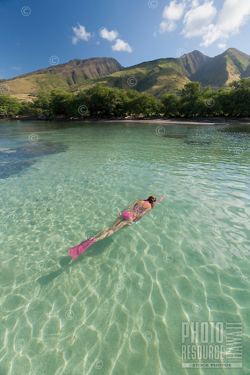 A woman snorkels at Olowalu, Maui.